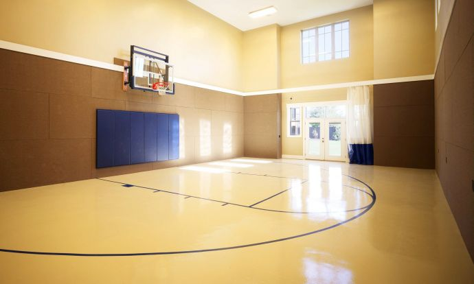 Interiors custom home design joe carrick design for Cost to build indoor basketball court
